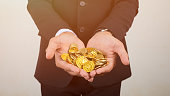 The money coin on hands  or  coins exchange in stock market.
