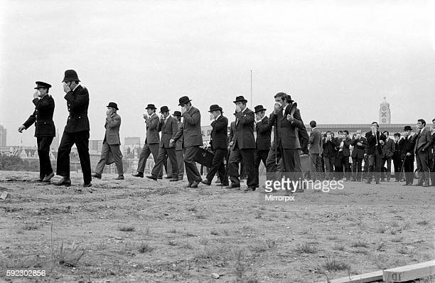 The money march as the crowd make their way to the sceptic pool which is looded with money June 1969 Z06342016