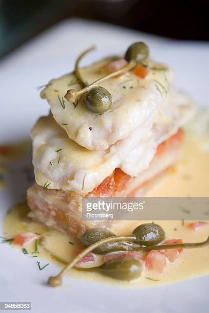 The monkfish medallion on fava bean puree at Barolo is displayed for a photo in Beijing China on Sunday May 11 2008 Barolo at the RitzCarlton is...