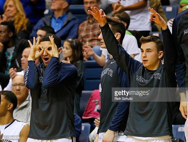 The Monmouth Hawks bench reacts to a three point shot against the Iona Gaels during the second half of a college basketball game at the MAC on...