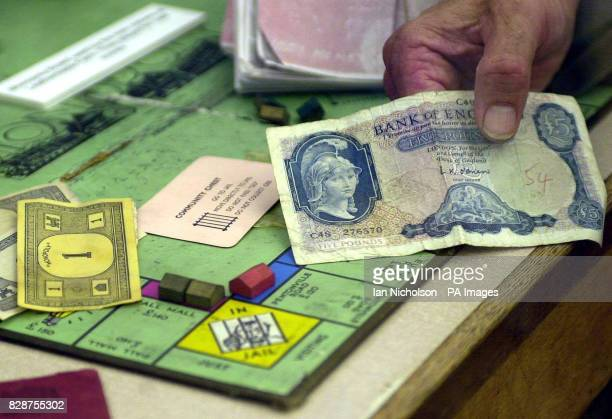 The Monopoly board on which the Great Train Robbers passed their time using real money while hiding out at Leatherslade Farm Buckinghamshire...