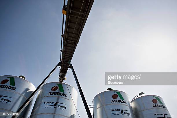 The Monsanto Co Asgrow soybeans logo is displayed on bulk storage bins at the Crop Protection Services facility in Manlius Illinois US on Friday...