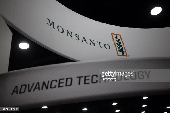 The Monsanto Co logo and signage are displayed at the company's booth at the National Farm Machinery Show in Louisville Kentucky US on Thursday Feb...