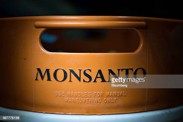 The Monsanto Co logo is displayed on a chemical barrel at the Crop Protection Services facility in Manlius Illinois US on Friday March 20 2015...
