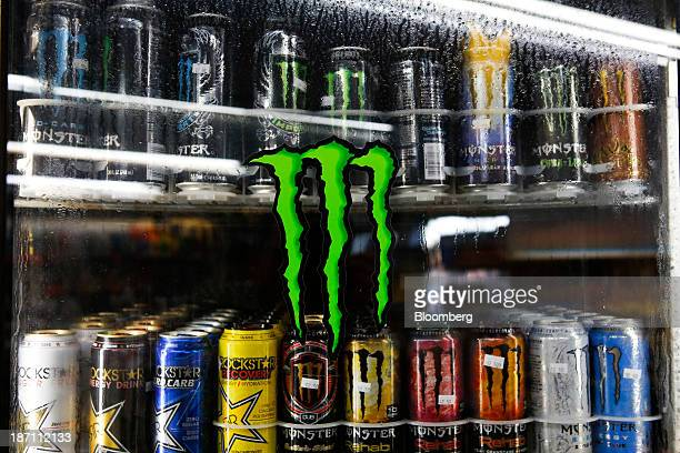 The Monster Beverage Corp logo is displayed on the window of a refrigerator housing cans of the company's energy drink for sale at a convenience...