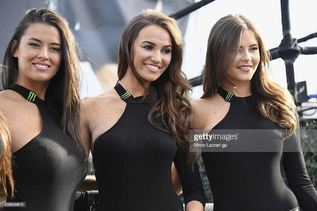 The Monster grid girls smile during the pre-event 'Valentino Rossi: The Doctor series' during the MotoGp of France - Press Conference on May 5, 2016 in Le Mans, France.