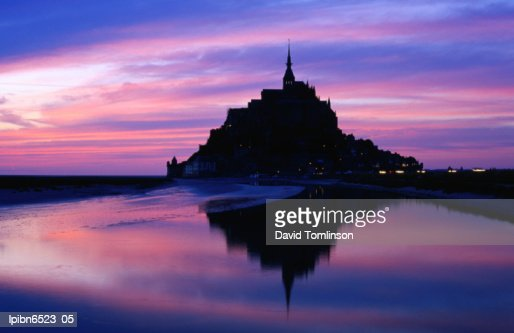 The Mont reflected in the bay at dusk., Mont St Michel, Basse-Normandy, France, Europe