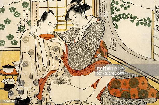 The month of August woman offering sake to her lover ca 1788 shunga by Katsukawa Shuncho woodcut from the The twelve months series Japanese...