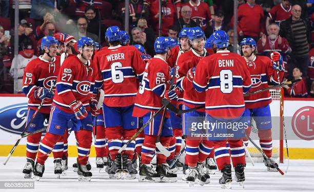 The Montreal Canadiens celebrate after defeating the Ottawa Senators in the NHL game at the Bell Centre on March 19 2017 in Montreal Quebec Canada