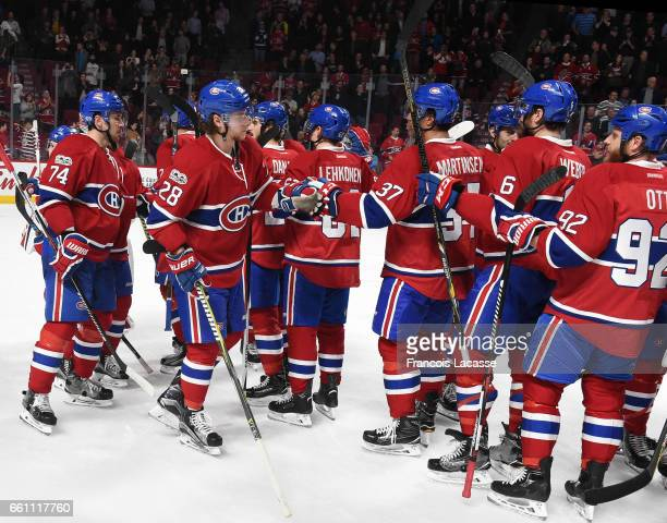 The Montreal Canadiens celebrate after defeating the the Florida Panthers in the NHL game at the Bell Centre on March 30 2017 in Montreal Quebec...