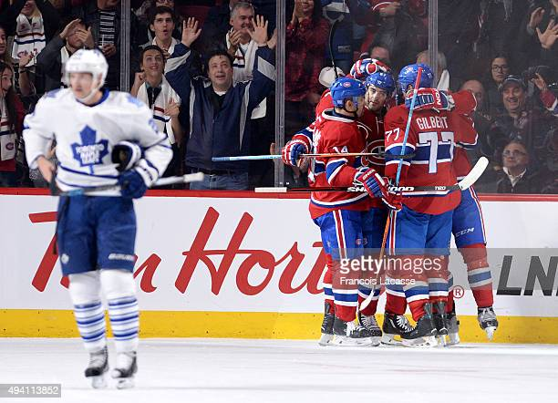 The Montreal Canadiens celebrate after scoring a goal against the Toronto Maple Leafs in the NHL game at the Bell Centre on October 24 2015 in...