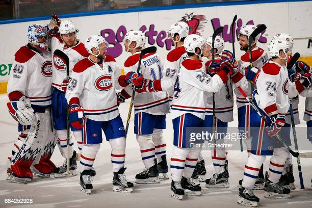 The Montreal Canadiens celebrate their 41 win over the Florida Panthers at the BBT Center on April 3 2017 in Sunrise Florida