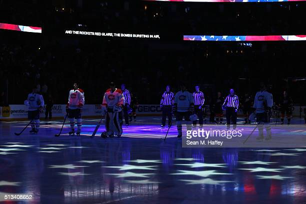 The Montreal Canadiens listen to the US national anthem prior to a game against the Anaheim Ducks at Honda Center on March 2 2016 in Anaheim...