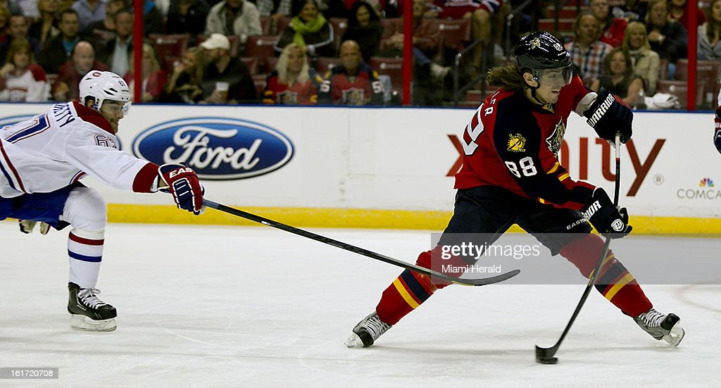 The Montreal Canadiens' Max Pacioretty, left, tries to keep the Florida Panthers' Peter Mueller (88) from taking a shot in the first period at BB&T Center in Sunrise, Florida, on Thursday, February 14, 2013. Montreal won in OT, 1-0.