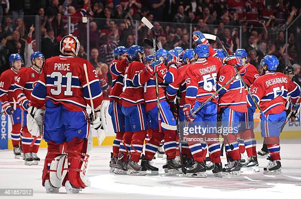 The Montreal Canadiens players celebrate the victory against the Nashville Predators in the NHL game at the Bell Centre on January 20 2015 in...
