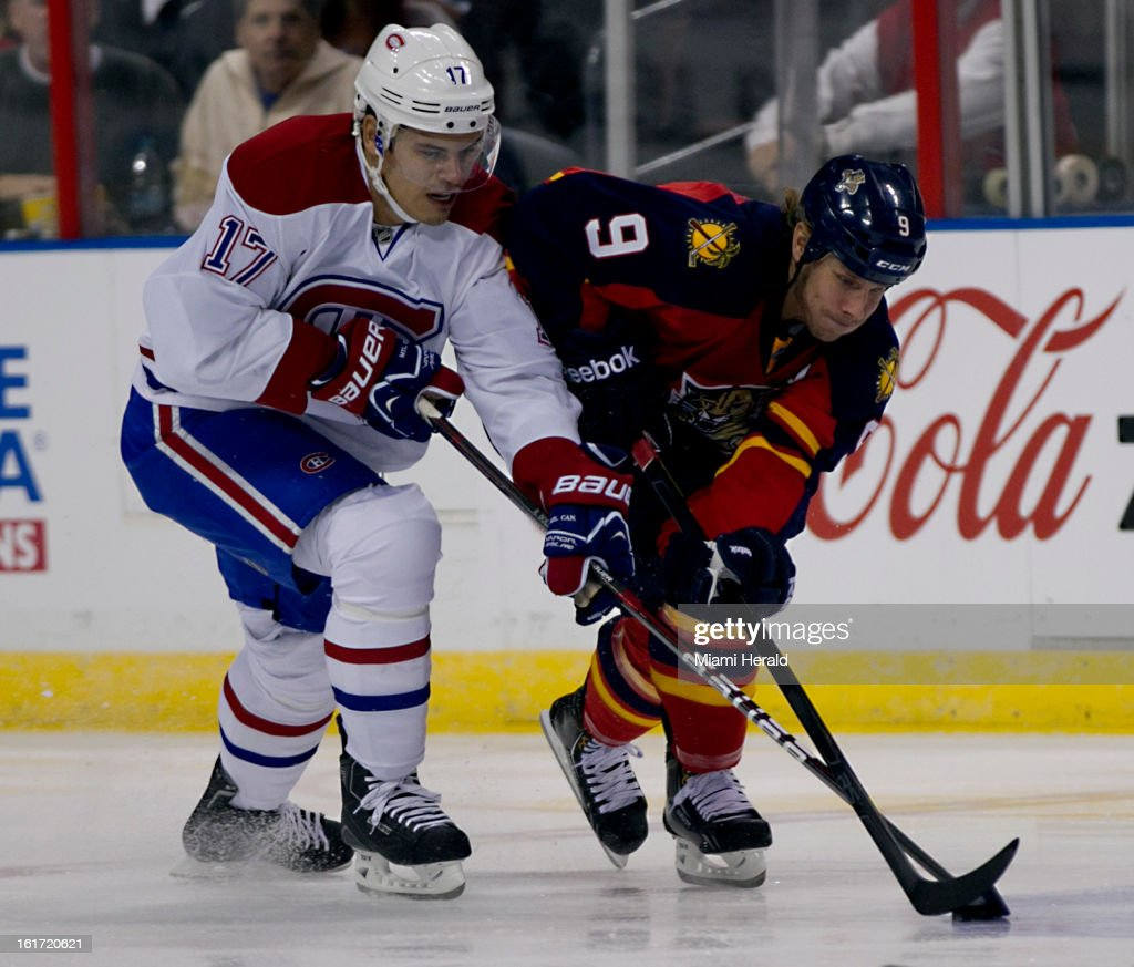 The Montreal Canadiens' Rene Bourque, left, and Stephen Weiss of the Florida Panthers battle for the puck in the first period at BB&T Center in Sunrise, Florida, on Thursday, February 14, 2013. Montreal won in OT, 1-0.
