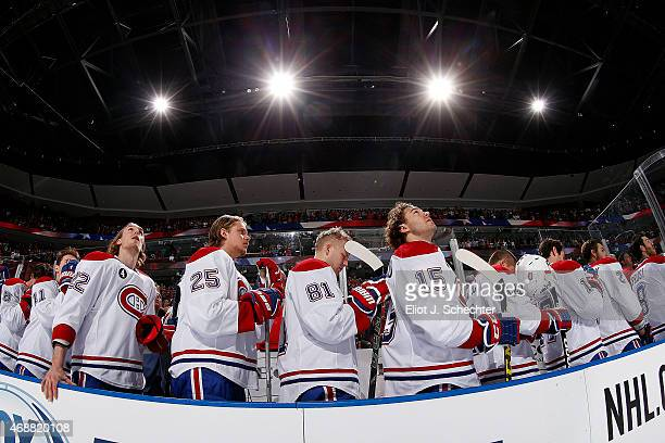 The Montreal Canadiens stand for the national anthems prior to the start of the game against the Florida Panthers at the BBT Center on April 5 2015...