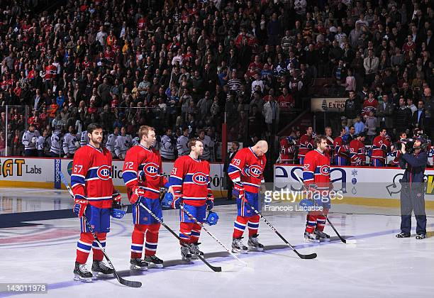 The Montreal Canadiens stand on the ice for the national anthem before the NHL game against the Toronto Maple Leafs on April 7 2012 at the Bell...