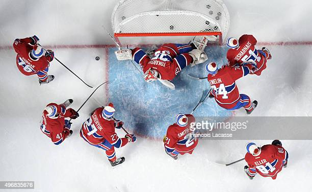 The Montreal Canadiens warm ups wearing a Winter Classic hat before the NHL game against the Boston Bruins in the NHL game at the Bell Centre on...
