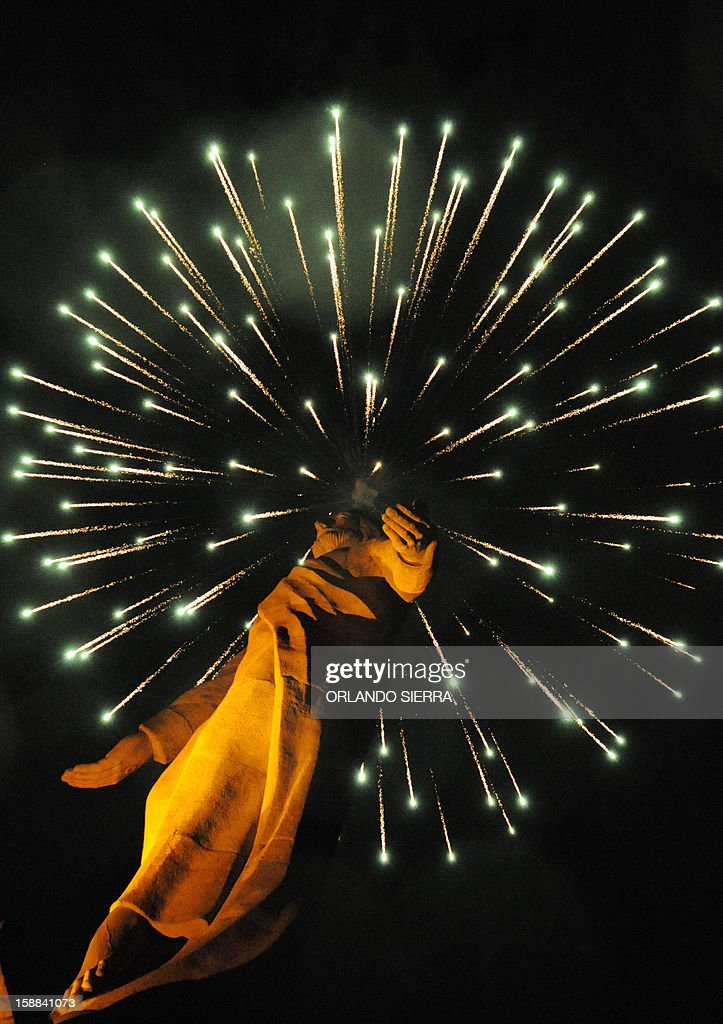 The monument of 'Cristo del Picacho' is iluminated with artificial lights on New year's Eve in Tegucigalpa, December 31, 2012. AFP PHOTO / Orlando SIERRA
