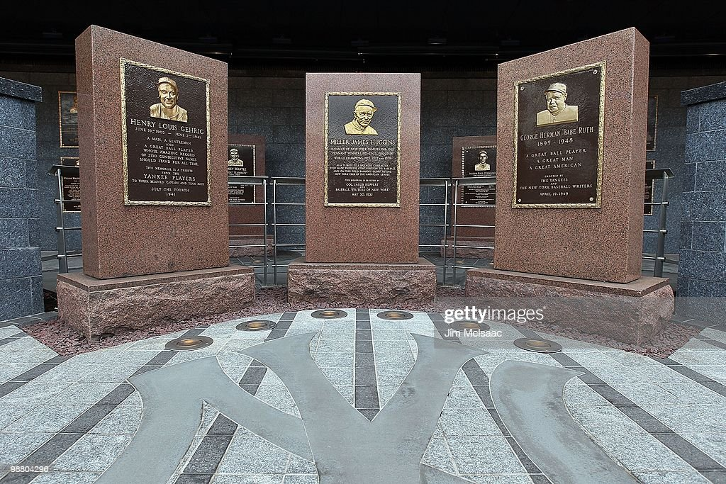 The monuments of Lou Gehrig Miller Huggins and Babe Ruth are seen in Monument Park at Yankee Stadium prior to game between the New York Yankees and...
