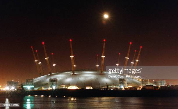 The moon attempts to outshine the Millennium Dome as the different light sequences are tested on the runup to the celebrations * The Dome has been...