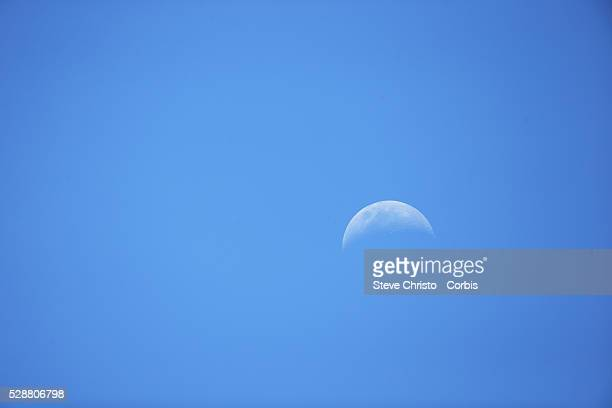The moon in a bright blue sky The Moon is the only natural satellite of the Earth and the fifth largest moon in the Solar System Sydney Australia...