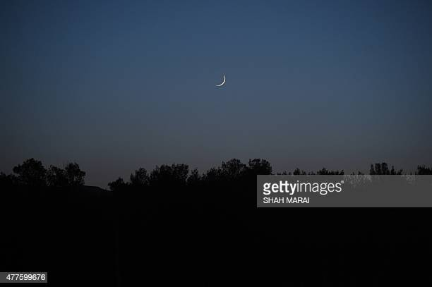 The moon is pictured in Bamiyan on the first day of the Muslim fasting month of Ramadan on 18 July 2015 Islam's holy month of Ramadan is celebrated...