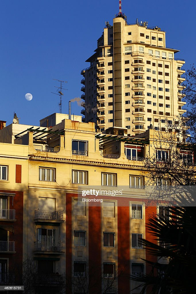 The moon is seen above residential housing in Madrid, Spain, on Monday, Jan. 13, 2014. Spain's rental market is growing as government-spending cuts, a 26 percent jobless rate and subdued mortgage lending make home buying more difficult. Photographer: Angel Navarrete/Bloomberg via Getty Images