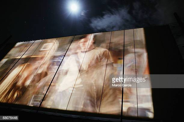 The moon is seen above the big screen showing the film 'The Perfect Man' starring Heather Locklear and Hilary Duff at the Celestial Cinema venue of...