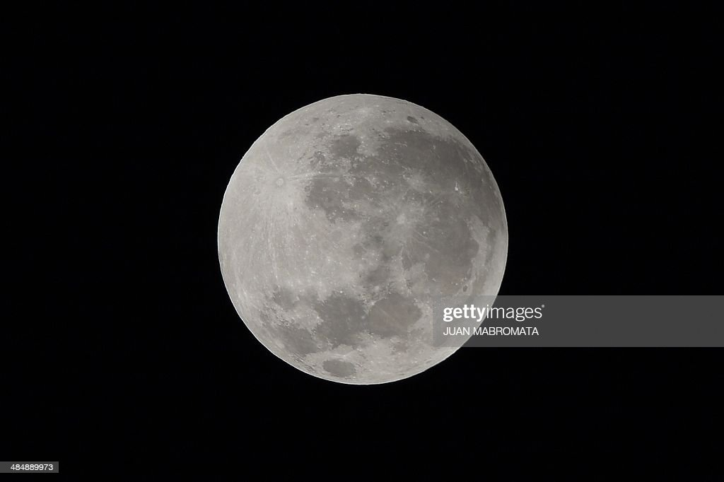 The moon is seen before a total eclipse in Buenos Aires on April 15, 2014. The entire event was to be visible from North and South America, but sky watchers in northern and and eastern Europe, eastern Africa, the Middle East and Central Asia were out of luck, according to US space agency NASA. AFP PHOTO / Juan Mabromata