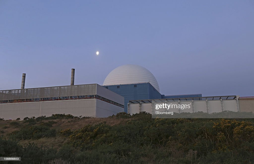 The moon is seen illuminated above the reactor dome at the Sizewell B nuclear power station, operated by Electricite de France SA (EDF), in Sizewell, U.K., on Wednesday, Jan. 2, 2013. EDF operates eight U.K. atomic power stations and has proposed to add Areva reactors at its Hinkley Point and Sizewell sites. Photographer: Chris Ratcliffe/Bloomberg via Getty Images