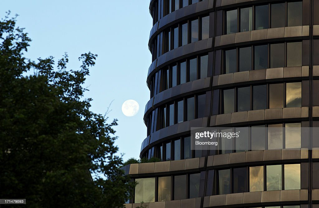The moon is seen in the early hours of the morning in the sky beyond the headquarters of the Bank for International Settlements (BIS) in Basel, Switzerland, on Tuesday, June 25, 2013. Central banks can't expand loose monetary policy without exacerbating risks to world economies, the Bank for International Settlements said this week. Photographer: Gianluca Colla/Bloomberg via Getty Images