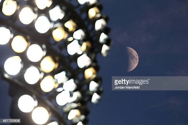The moon is seen next to the floodlights during the Natwest T20 Blast match between Kent Spitfires and Hampshire at St Lawrence Ground on July 4 2014...