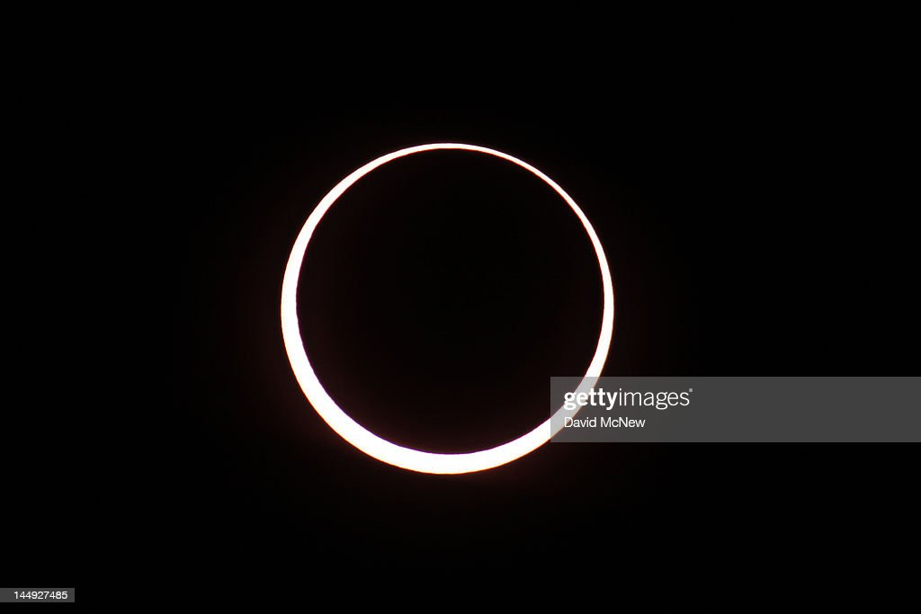 The moon passes before the sun in the first annular eclipse seen in the U.S. since 1994 on May 20, 2012 in Grand Canyon National Park, Arizona. Differing from a total solar eclipse, the moon in an annular eclipse appears too small to cover the sun completely, leaving a ring of fire effect around the moon. The eclipse is casting a shallow path crossing the West from west Texas to Oregon then arcing across the northern Pacific Ocean to Tokyo, Japan.