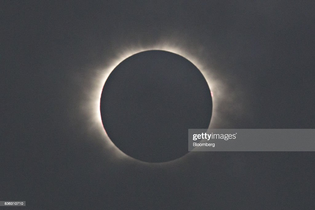 The moon passes in front of the sun during a solar eclipse seen from a viewing event on the campus of Southern Illinois University (SIU) in Carbondale, Illinois, U.S., on Monday, Aug. 21, 2017. Millions of Americans across a 70-mile-wide (113-kilometer) corridor from Oregon to South Carolina will see the sky darken as the sun disappears from view total during the eclipse, with Carbondale seeing totality for 2 minutes and 38 seconds. Photographer: Daniel Acker/Bloomberg via Getty Images