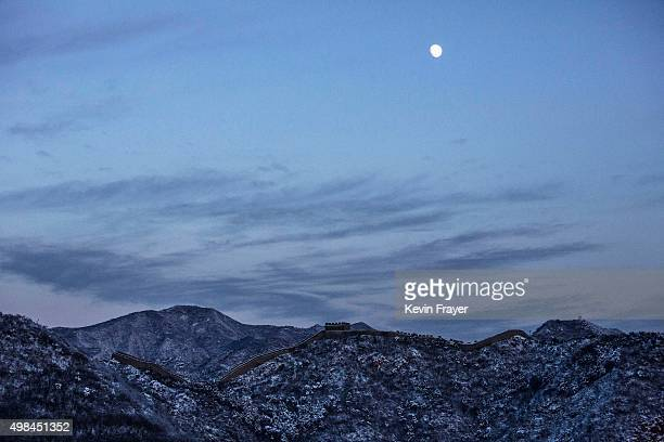 The moon rises as snow is seen on the Great Wall after a snowfall on November 23 2015 near Beijing China China's capital and the northern part of the...