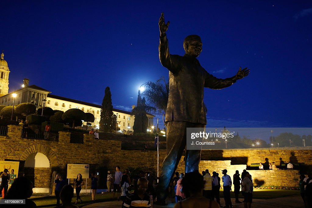 The moon rises over a statue of former South African President Nelson Mandela that was unveiled at the Union Buildings on December 16, 2013 in Pretoria, South Africa. The statue was dedicated on the day after the burial of Nelson Mandela in his home village of Qunu on December 15, 2013. Nelson Mandela passed away on the evening of December 5, 2013 at his home in Houghton at the age of 95. Mandela became South Africa's first black president in 1994 after spending 27 years in jail for his activism against apartheid in a racially-divided South Africa. December 16 is celebrated in South Africa as Reconciliation Day and marks several significant events in South African history.