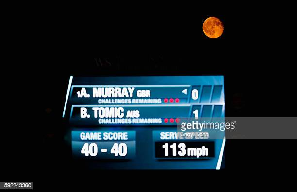 The moon rises over the scoreboard during the quarterfinal match between Andy Murray of Great Britain and Bernard Tomic of Australia during day 7 of...