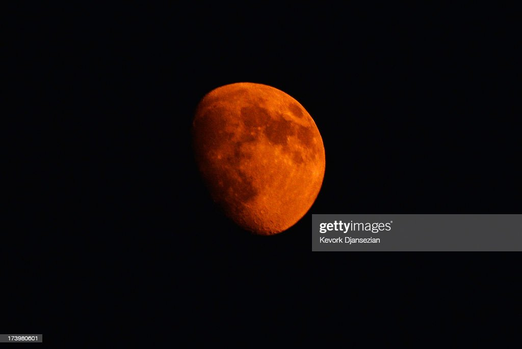 The moon turns an orange color from the smoke of the Mountain Fire July 18, 2013 near Idyllwild, California. The massive wildfire in Riverside County has grown to 23,000 acres and is advancing toward the mountain town of Idyllwild on one front and city of Palm Springs on the other front destroying several homes and forcing the evacuation of 6,000 people.
