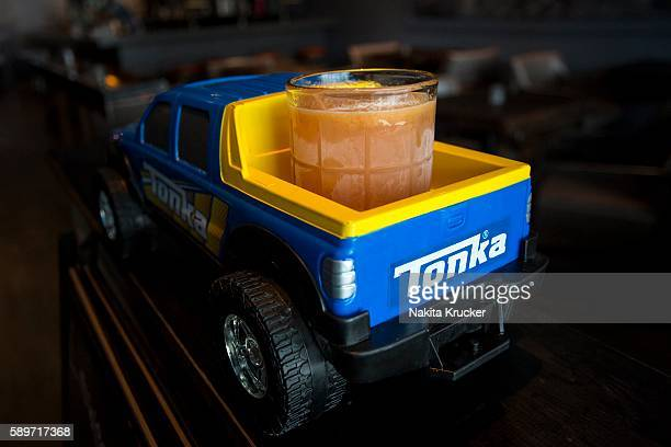 TORONTO ON JULY 14 The Moonrunner cocktail from Linwood Essentials is brought out in the back of a Tonka pickup truck An Instagramworthy cocktail