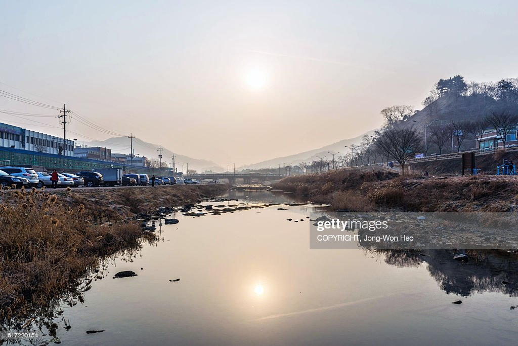 The morning over the brook that flows through the town : Stock Photo