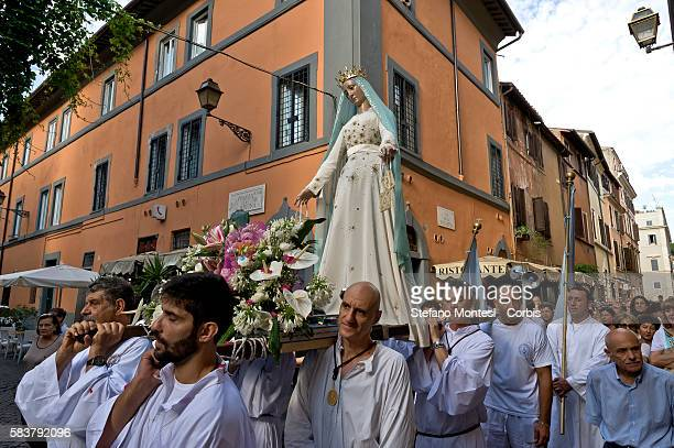 The morning procession in honor of Madonna del Carmine called 'de 'Noantri' from Basilica of Santa Maria in Trasteverecrossing the streets of...