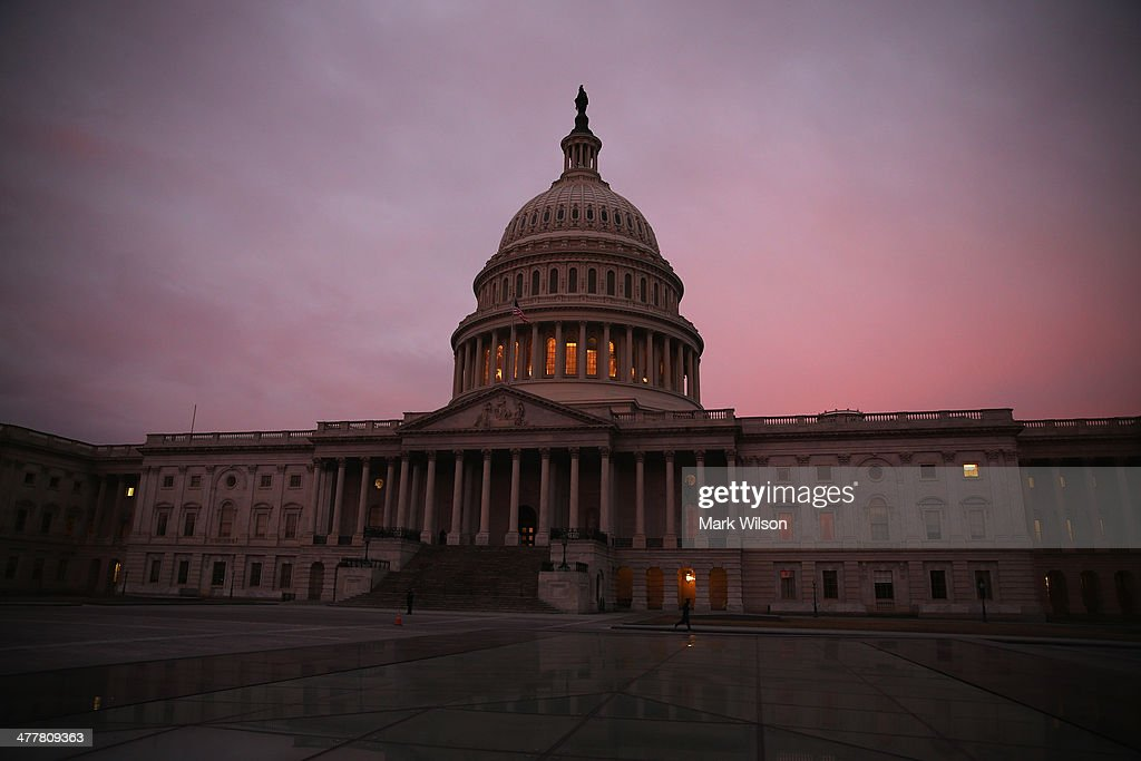 The morning sun begins to rise in front of the US Capitol as Senate Democrats speak nonstop on the chamber floor about climate change on March 11...