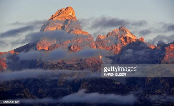 The morning Sun hits the tips of the Grand Tetons October 5 2012 in the Grand Teton National Park in Wyoming Grand Teton National Park is located in...
