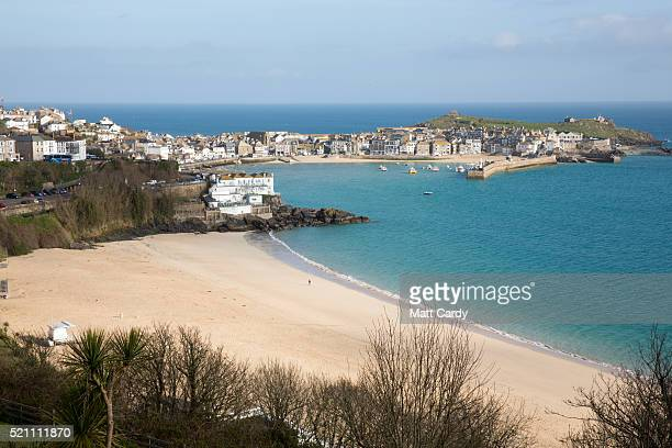 The morning sun illuminates properties in the popular seaside resort of St Ives on April 14 2016 in Cornwall England Due to the pressures that second...