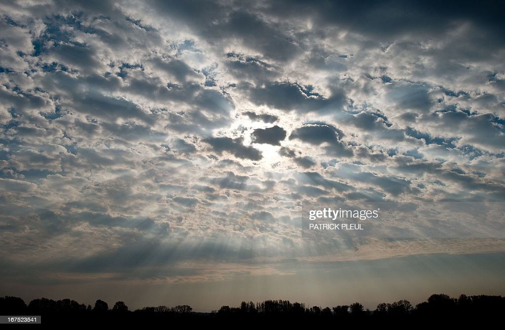 The morning sun shines through a mackarel sky onto the Oderbruch area near Reitwein, eastern Germany, on April 26, 2013.