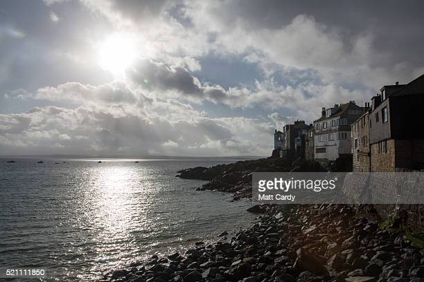 The morning sun tries to break through cloud above the sea in the popular seaside resort of St Ives on April 14 2016 in Cornwall England Due to the...