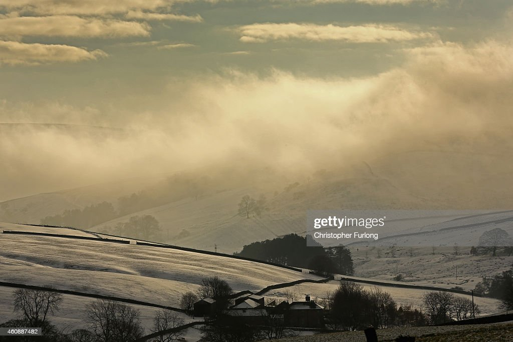 The morning sun tries to break through freezing fog on the hilltops in the High Peak near Macclesfield on December 29, 2014 in Macclesfield, United Kingdom. According to the Met Office Britain experienced the coldest night of the year overnight, with some areas being even colder than Alaska and the Antarctica and as forecasters believe it could get even colder tonight, a Met Office cold weather alert for northern England and the Midlands has warned of health risks for vulnerable people.