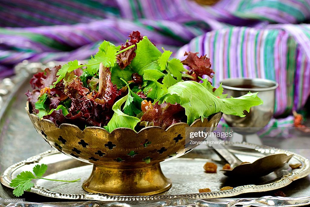 The Moroccan green salad with hot sauce and raisin : Stock Photo